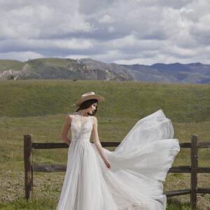 Woman in white dress in a field