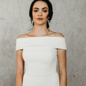 Woman wearing white dress with grey background