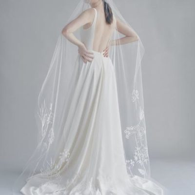 Woman in white dress and long white veil